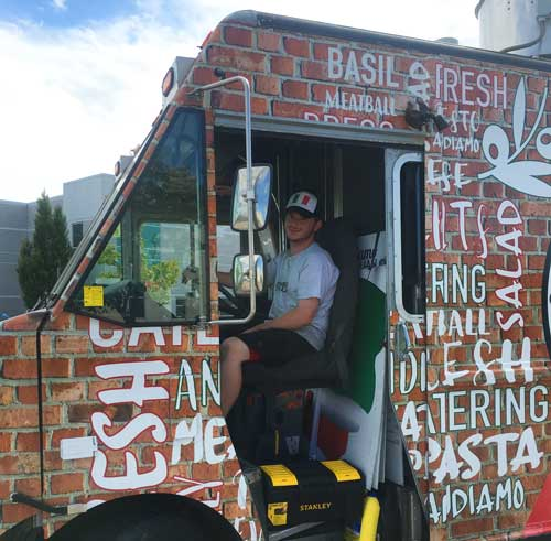 Alex from Andiamo Italian sitting in his food truck